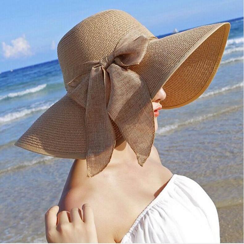 ใหม่หมวกฟางสำหรับสตรีฤดูร้อนฤดูใบไม้ผลิกว้าง brim Beach หมวกกันแดดขนาดใหญ่ Bow floppy sunhat