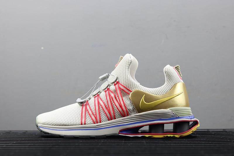 2d914b5b012b Nike Shox Gravity Men s Running Shoe Fashion Sport Sneakers (White Golden)