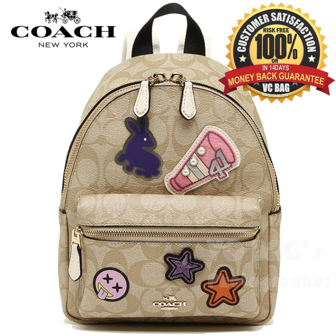 28b83670875a COACH F20909 Mini Charlie Backpack In Signature Coated Canvas with Varsity  Patches  Light Gold