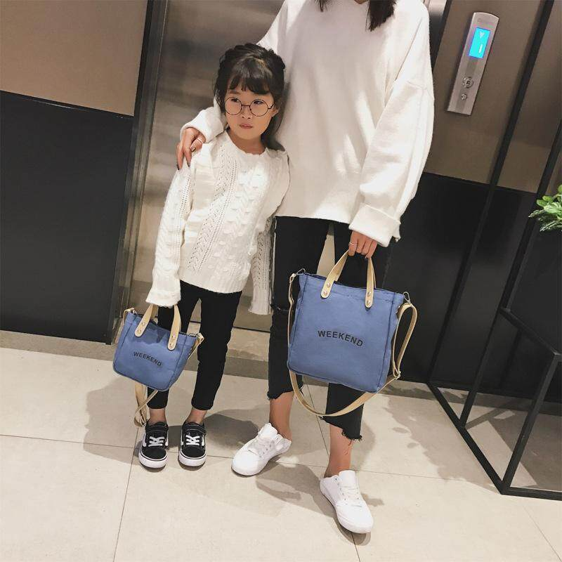 2 sets 2019 new trend mother and daughter travel shoulder bag wild simple canvas parent-child handbag Korean childrens bag one big one small