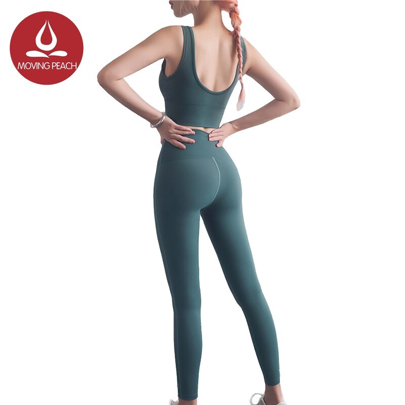 Moving Peach Women Sportswear Fitness Tank Top And Compression Pants.