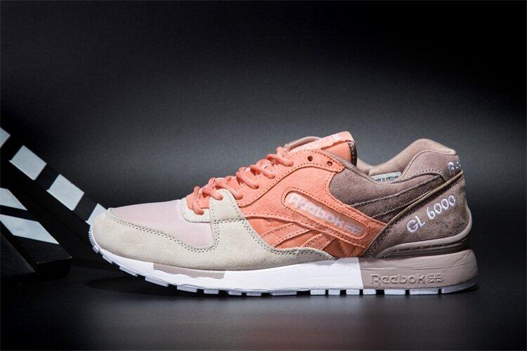 Reebok Wanita dan Pria Sepatu Kasual GL6000 Olahraga Sepatu Lari Reebok  Klasik Sepatu Jalan (Oranye bfe431cce5