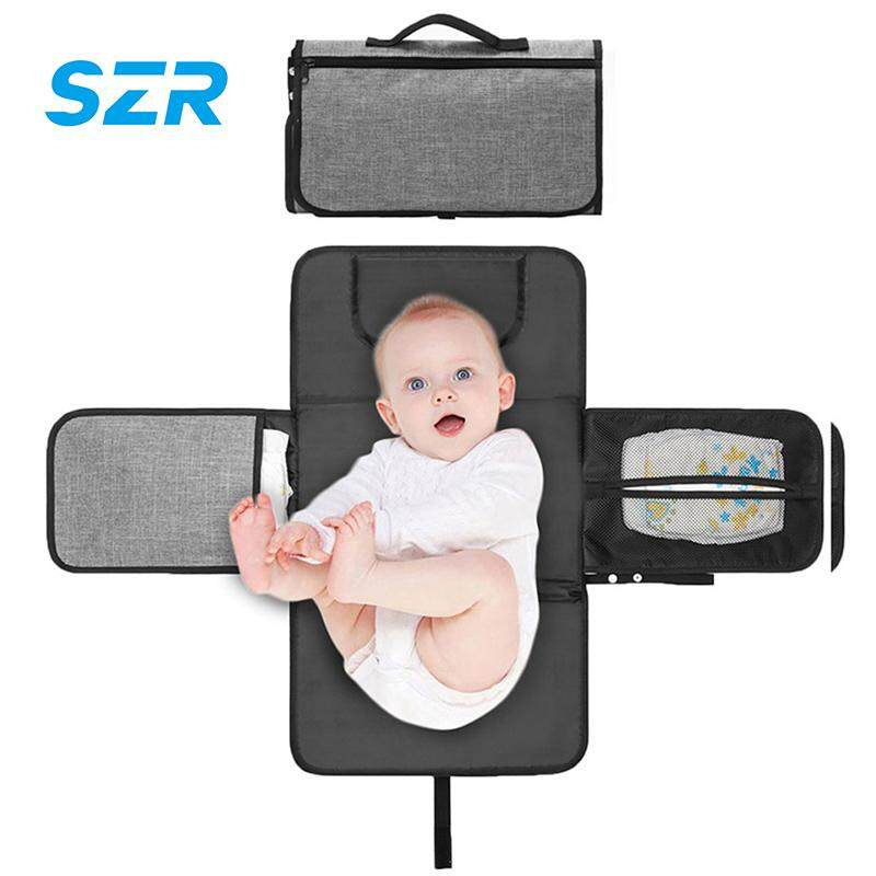 SZR Diaper Changing Pad Baby Portable Changing Station Diaper Change Mat with Head Cushion Lightweight Travel Home Diaper Changer Mat with Pockets - Waterproof and Foldable